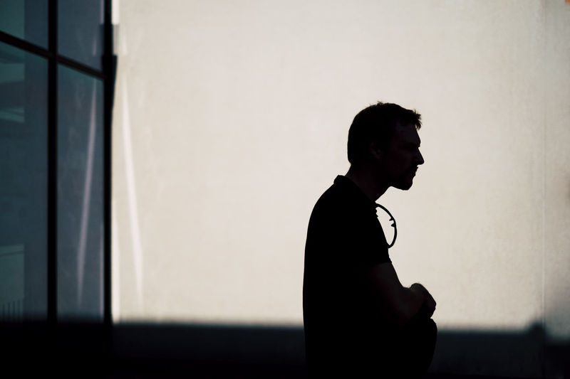 One Person Side View Real People Standing Lifestyles Waist Up Men Young Men Three Quarter Length Young Adult Contemplation Leisure Activity Looking Architecture Indoors  Wall - Building Feature Built Structure Silhouette Profile View The Art Of Street Photography