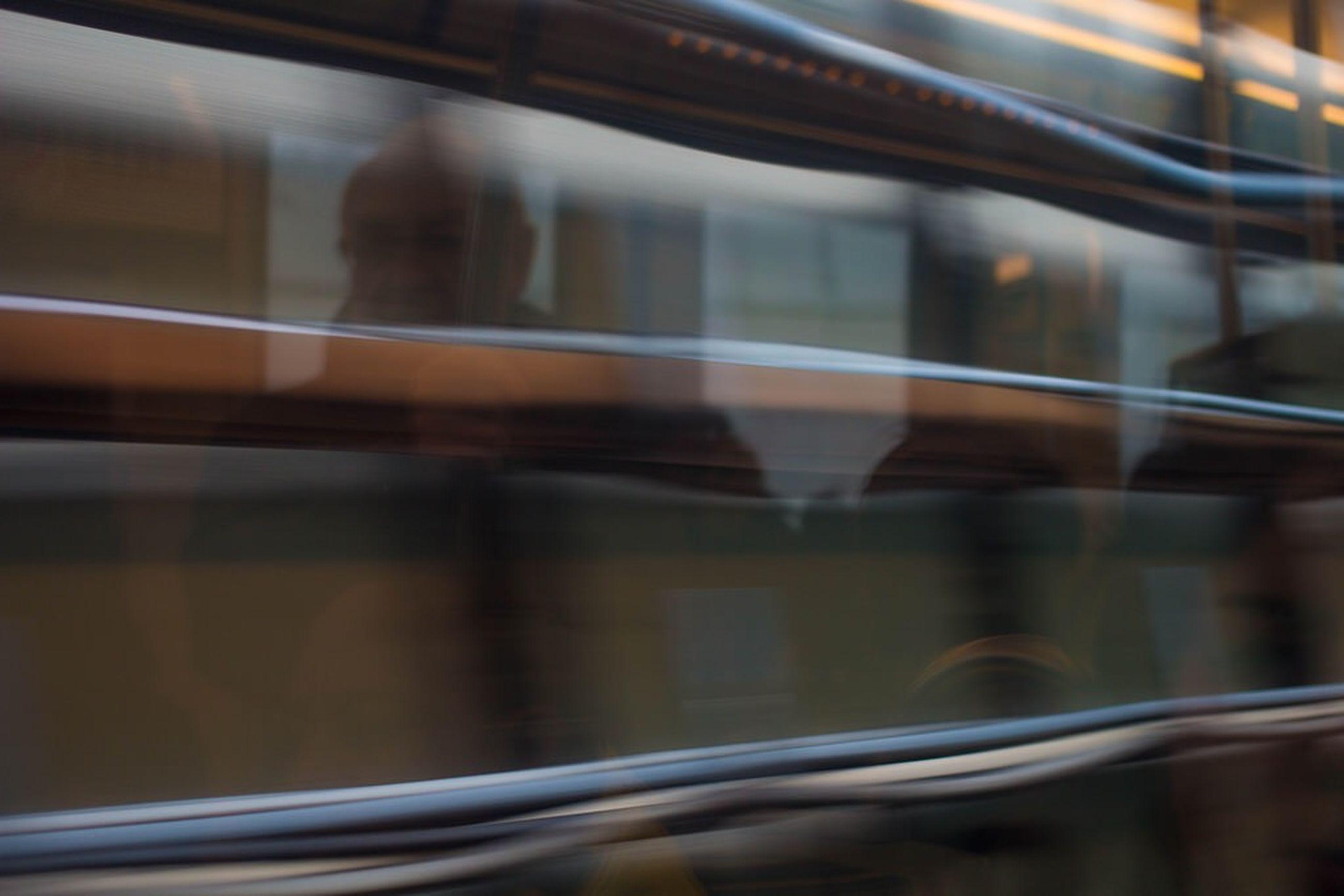 blurred motion, transportation, motion, indoors, public transportation, speed, reflection, rail transportation, train - vehicle, selective focus, on the move, long exposure, railroad track, mode of transport, glass - material, window, transparent, railroad station platform, train
