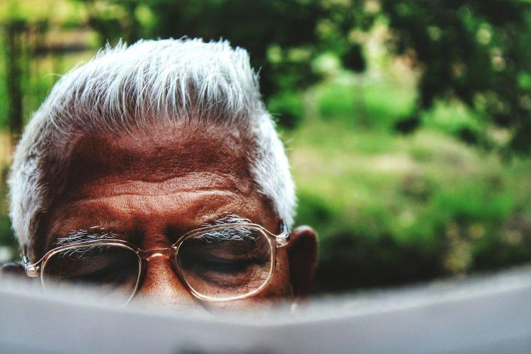 Cropped Image Of Senior Man Wearing Eyeglasses