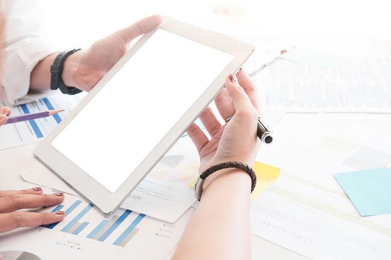 Business people Consulting and business planning. Business Business Person Communication Computer Connection Digital Tablet Finger Hand Holding Human Body Part Human Hand Indoors  One Person Portable Information Device Real People Screen Technology Touch Screen Wireless Technology Working