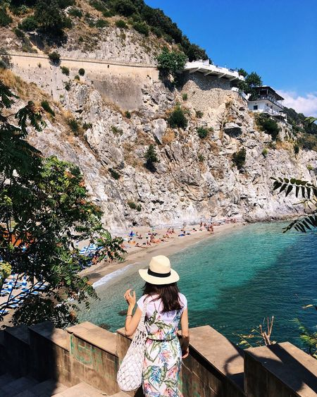 View on the beach. Cetara, Italy Colorful Travel Cetara Italy Golden Hour Water Real People Lifestyles Nature One Person Day High Angle View Sunlight Leisure Activity Hat Plant Sea Adult Clothing Rear View Beach Women Outdoors