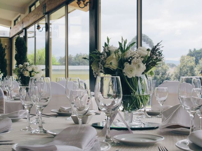 Wedding Dinner Flower Arrangement Wedding Party Glases Light Bright Room Brigth White Decorations Light And Reflection
