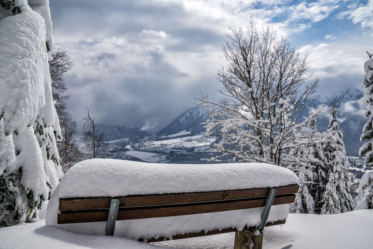 Snowy bench Snow Winter Cold Temperature Scenics - Nature Nature Cloud - Sky Sky Mountain Tree Beauty In Nature Day Tranquility No People Tranquil Scene Snowcapped Mountain Bench Wood - Material Plant White Color Snowing Blizzard Alps Tyrol Austria