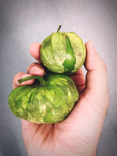 Cropped Hand Of Person Holding Fruits