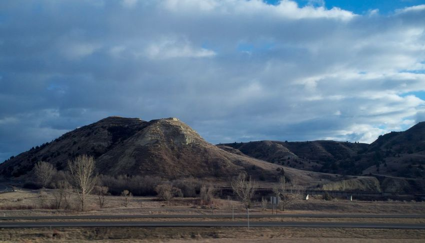 2-7-16 Arid Climate Beauty In Nature Cloud Cloudy Geology Geometry Horizon Over Land Horizontal Symmetry Landscape Mountain Mountain Range Nature No People Non-urban Scene North Dakota Outdoors Physical Geography Remote Scenics Sky Symmetry Tranquil Scene Tranquility Trip Western North Dakota