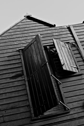 Architecture Black And White Building Exterior Built Structure Clear Sky Fishing Fishing Village Hastings Low Angle View No People Outdoors Photographer Roof Sky Wooden Wooden Texture