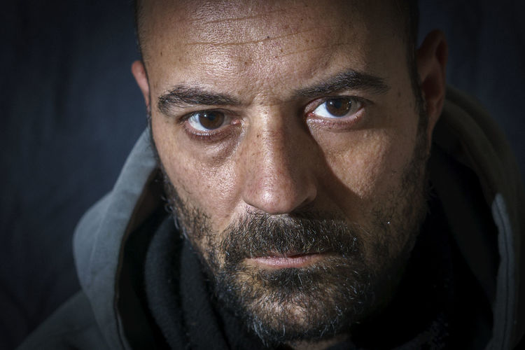 Close-up portrait of man wearing hooded shirt