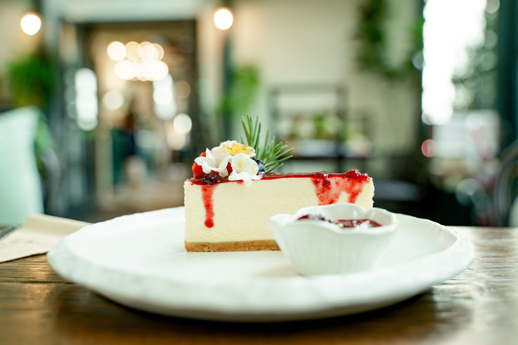 View of cake with ice cream in plate on table
