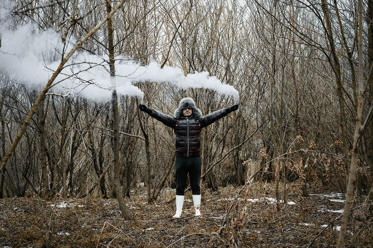 Don't get lost. Smoke Smoke - Physical Structure Smoke Bomb Forest Tree Trees Bare Tree Cold Temperature One Person Men Warm Clothing Winter Standing Full Length Arms Raised Arms Outstretched Posing Cold