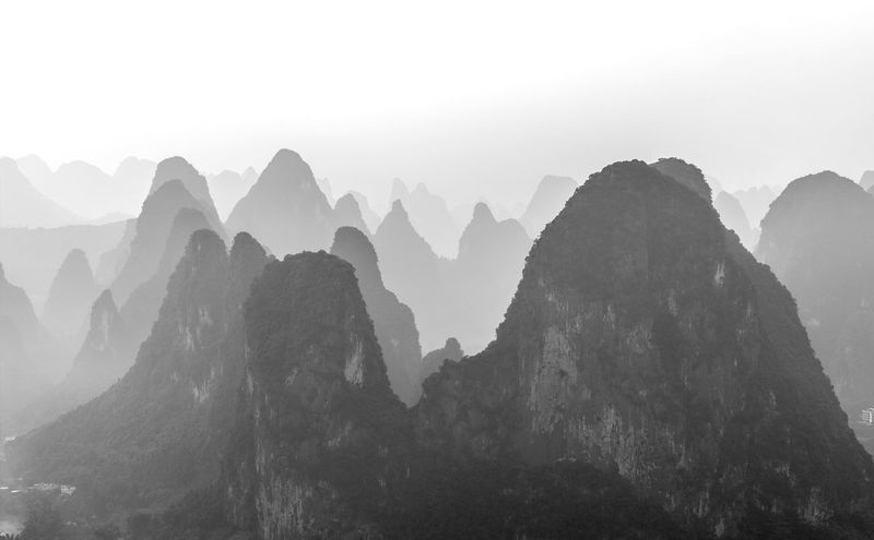 Limestone karst rock formations in Guangxi, China Beauty In Nature Black And White China Day Guangxi High Contrast High Resolution Karst Landscape Limestone Mountain Mountainous Nature No People Scenics Sky Tranquility Travel Destinations Yangshuo