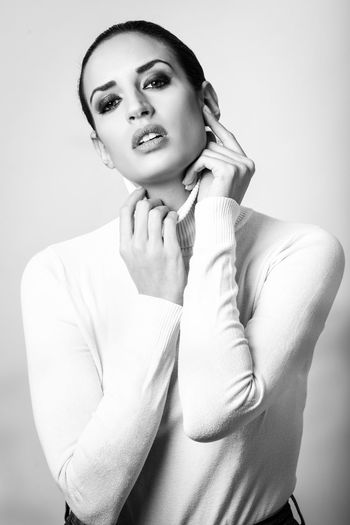 Portrait Of Woman Wearing Turtleneck Against White Background