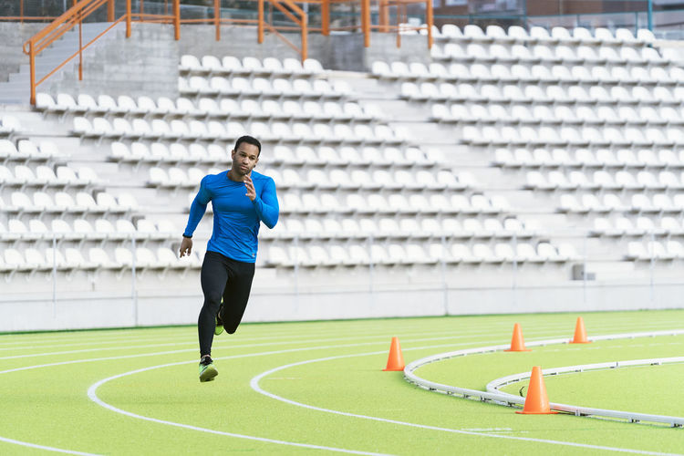 Male athlete running at sports track