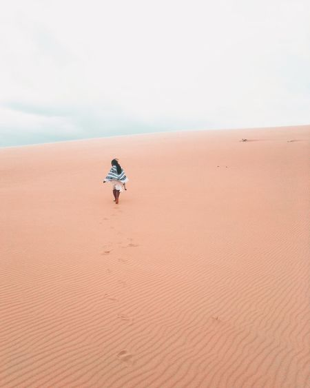 Woman in desert Woman Land Sand Desert Sand Dune Scenics - Nature Landscape Sky One Person Real People Beauty In Nature Copy Space