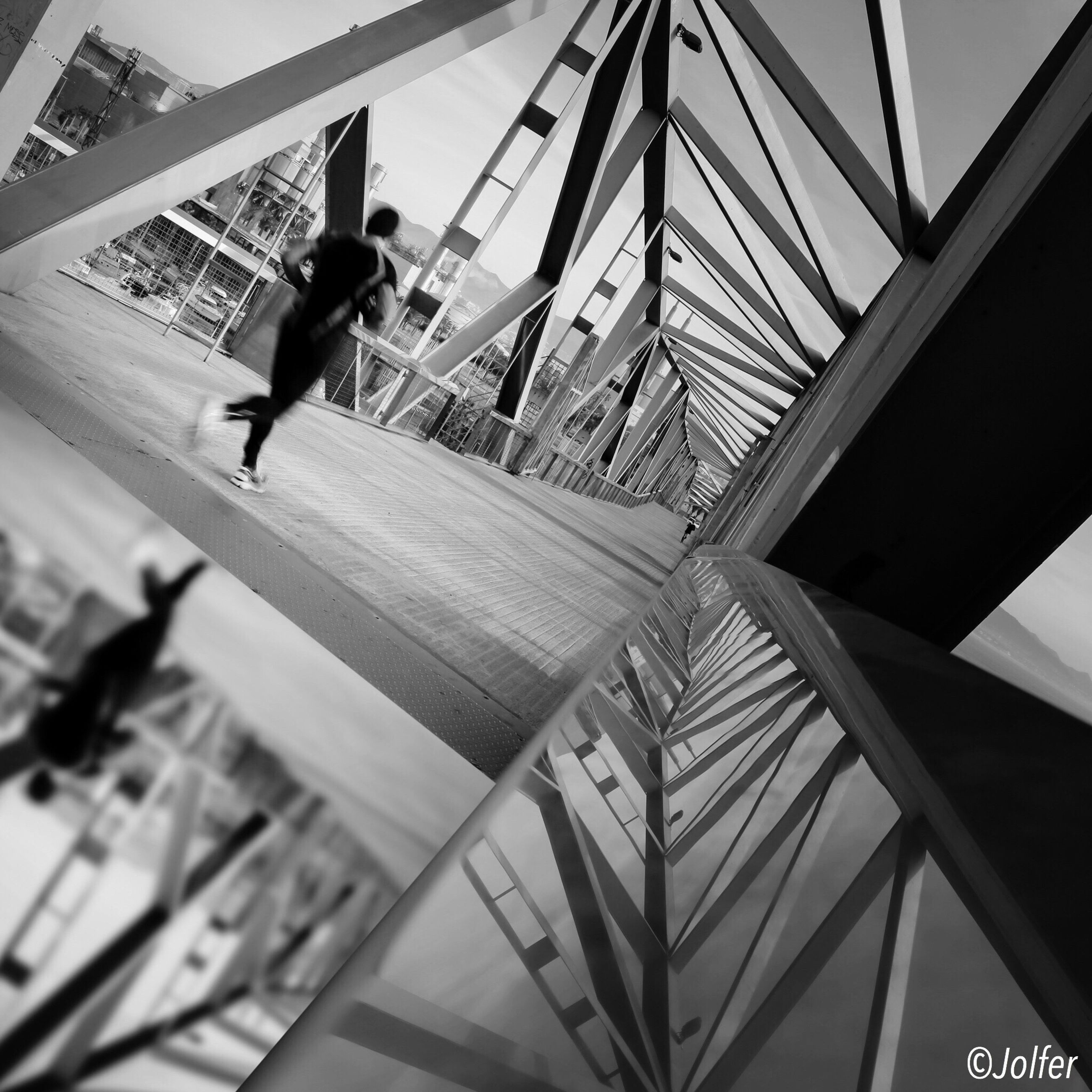 men, lifestyles, leisure activity, built structure, low angle view, architecture, full length, railing, bridge - man made structure, sky, person, connection, transportation, walking, silhouette, day, travel, engineering