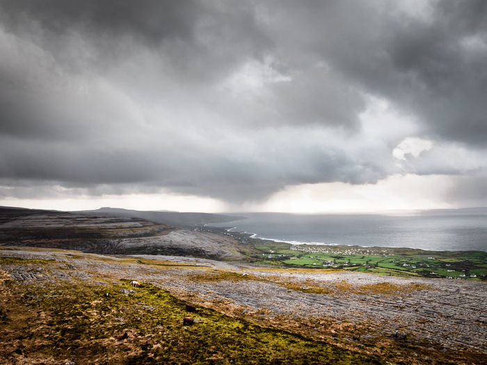 A rain shower passes over Fanore village Fanore Ireland Landscape_Collection The Burren Beauty In Nature Cloud - Sky Day Landscape Mountain Nature No People Outdoors Scenics Sky Storm Cloud Tranquil Scene Tranquility Water West Coast