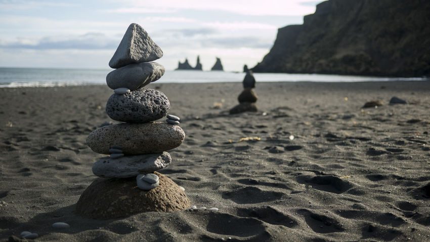 Balance Beach Beauty In Nature Black Beach Black Beach Iceland Black Sand Close-up Day Focus On Foreground Iceland Nature No People Outdoors Pebble Rock - Object Sand Scenics Sea Sky Stack Tranquility Vik Vík í Mýrdal Water