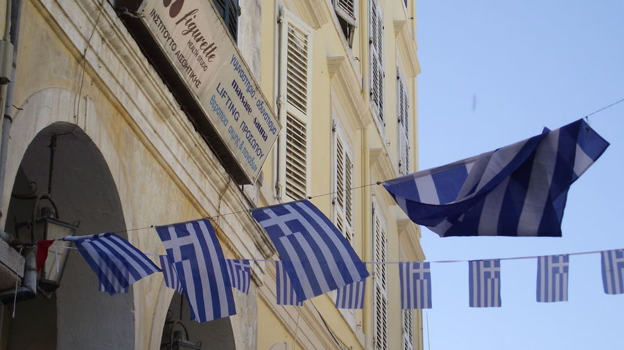 Building Built Structure City Hanging Low Angle View National Flag Patriotism Sky Greece