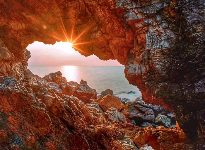 Water Sea Sunset Beach Awe Sun Sky Horizon Over Water Close-up Natural Arch Rocky Mountains Rocky Coastline Rock Formation