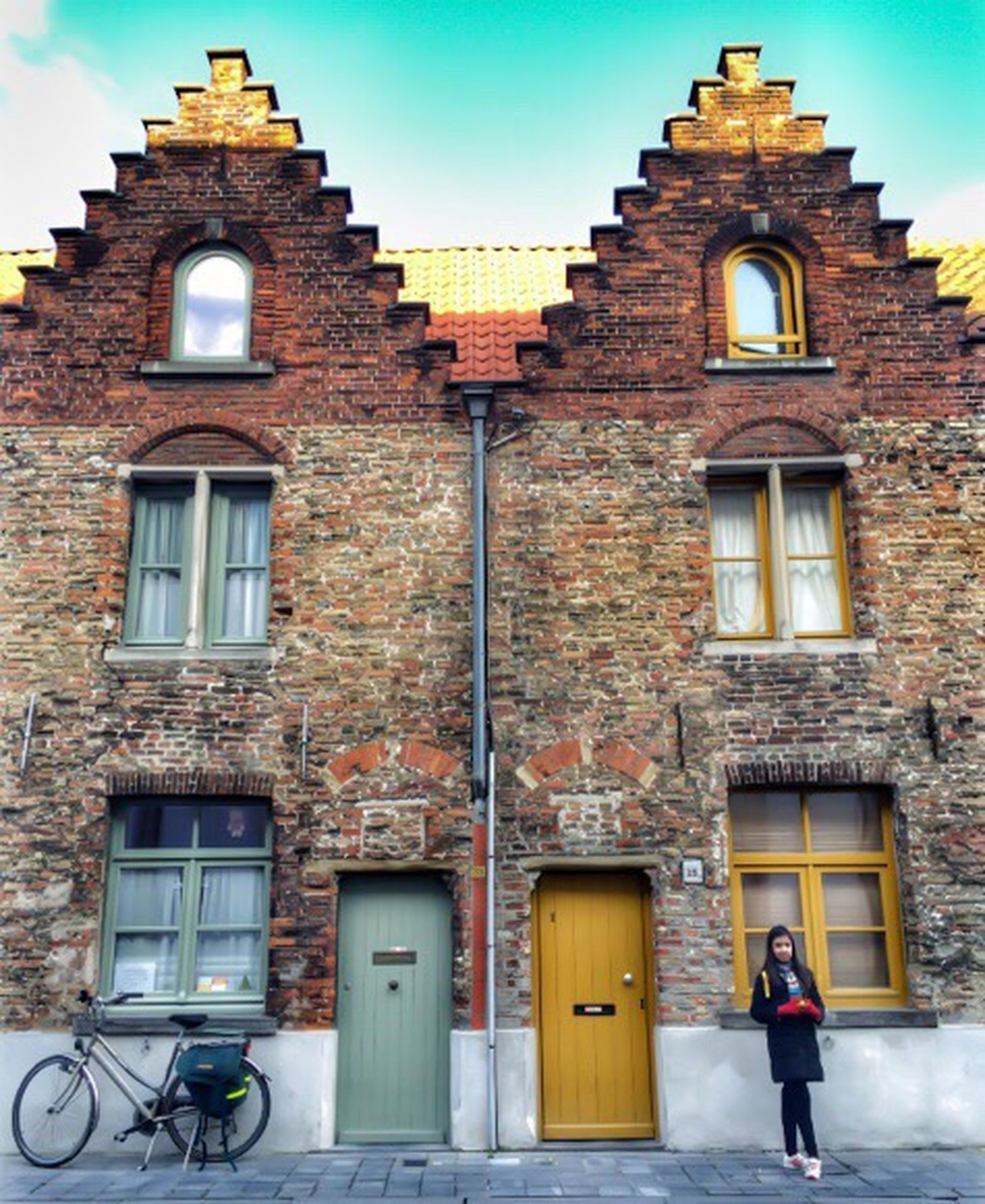building exterior, architecture, built structure, window, arch, facade, low angle view, walking, lifestyles, men, house, sky, day, outdoors, clear sky, full length, residential structure, person