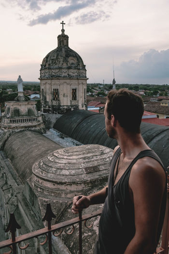 Adult Architecture Architecture Backpacker Cathedral City Day Dome Evening Man Nicaragua One Man Only One Person Outdoors People Rear View Sky Tanned Tourism Tourist Travel Travel Travel Destinations View From Above Young Man