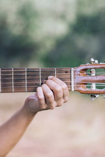 Cropped hand playing musical instrument