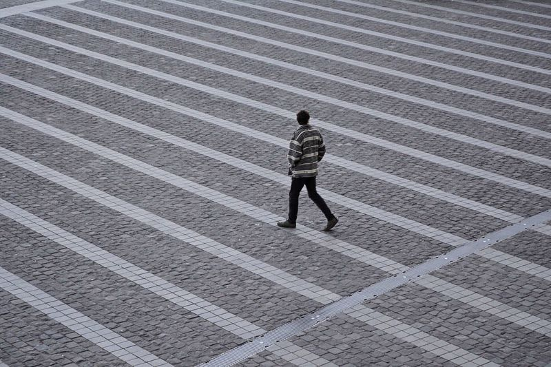 TCPM Layers Full Length One Person High Angle View Real People Outdoors Steps Men Architecture One Man Only City Minimalmood Minimalism Break The Mold Minimalpeople Architecture Architectural Feature Architectureandpeople Pattern Stripes Pattern Streetphotography Street Photography Strideby Art Is Everywhere The Street Photographer - 2017 EyeEm Awards