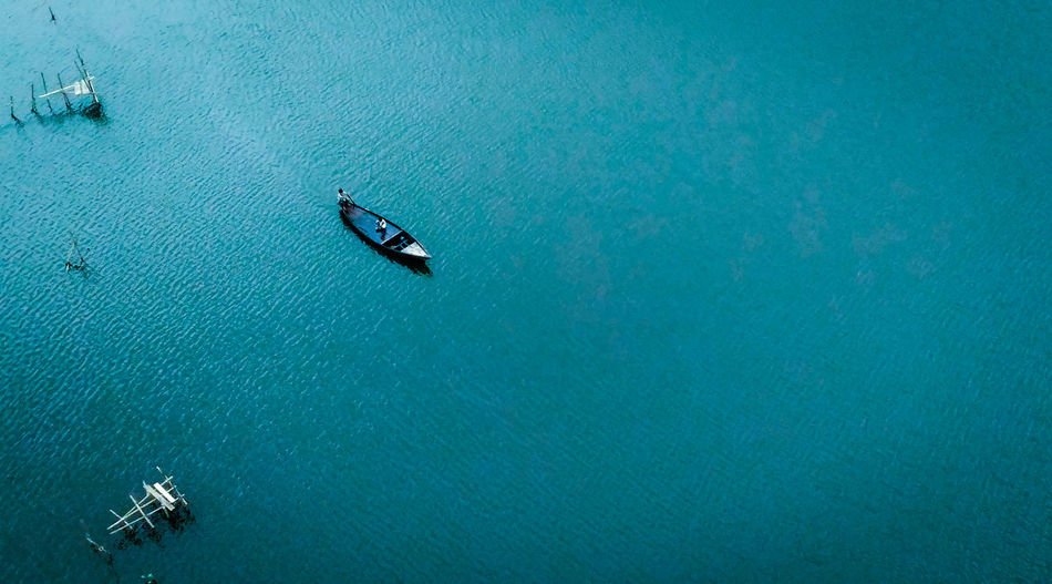 Minimalistic photography of a boat on river Lonely Lonelyplanet Loneliness Alone All Alone Landscape_Collection Landscape_photography Landscape #Nature #photography Boatman Lone Nature Nature_collection Nature Photography Naturelovers Nature On Your Doorstep Water Nautical Vessel Rowing Aerial View Blue High Angle View Oar Adventure Drone  Boat Water Vehicle Wake - Water Sailing