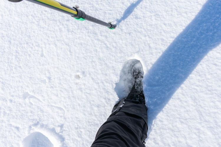 A mountaineer woman walking in snowy mountain