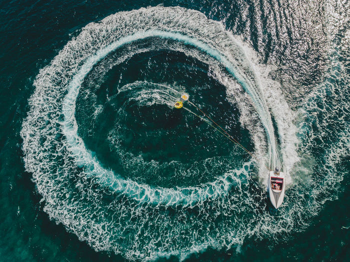 TAKE THE RIDE | @LostBoyMemoirs [Snapped in Poros, Greece at a waters sports destination with 2 tube riders being flung off as the speedboat makes a complete circle in the sea to create this unique aerial. Shot on DJI Phantom 4] Aerial Shot Circle DJI X Eyeem EyeEm Best Shots The Week on EyeEm Travel Water Sport Aerial Circles Directly Above Dji Floating On Water Greece High Angle View Nature Sea Speedboat Symmetry Tourism Wallpaper Water