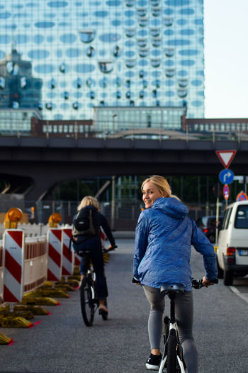 Woman Riding Bicycle On Street