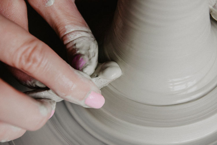 Cropped hand of woman working in workshop