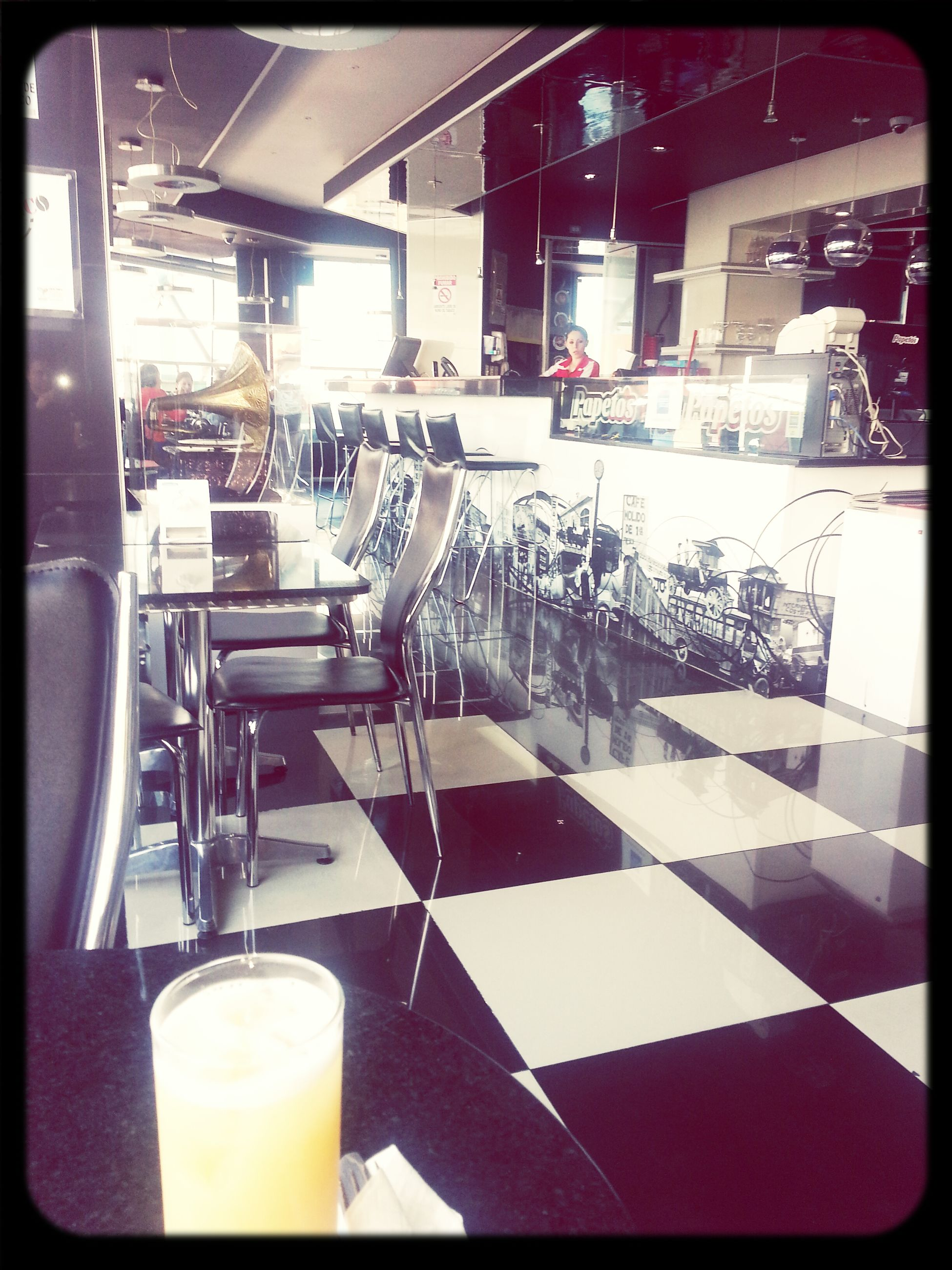 transfer print, auto post production filter, chair, table, indoors, restaurant, architecture, built structure, sunlight, sidewalk cafe, building exterior, day, drink, absence, sitting, glass - material, empty, incidental people, seat, shadow