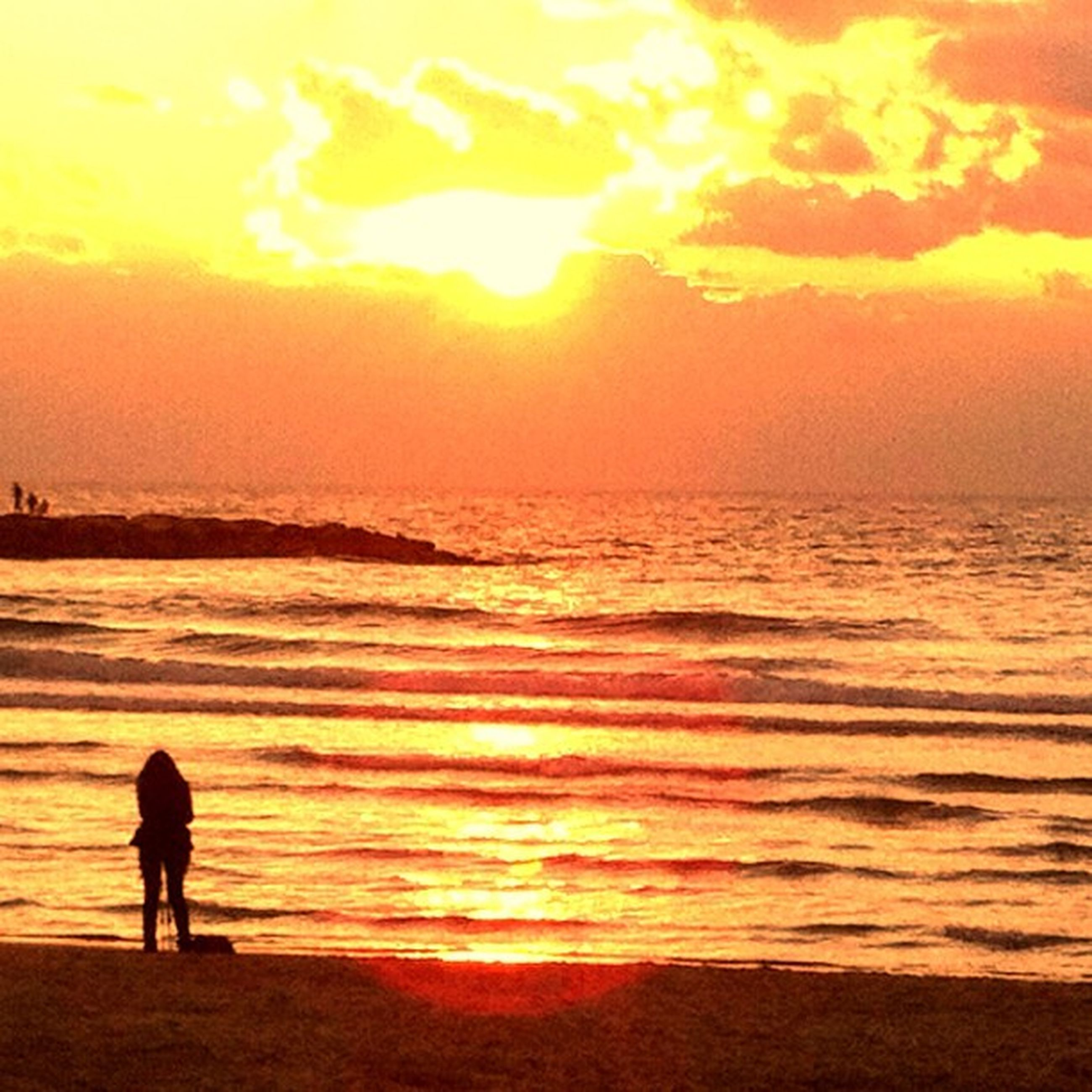 sunset, sea, beach, water, silhouette, orange color, horizon over water, sky, sun, scenics, lifestyles, beauty in nature, leisure activity, shore, tranquil scene, men, tranquility, standing