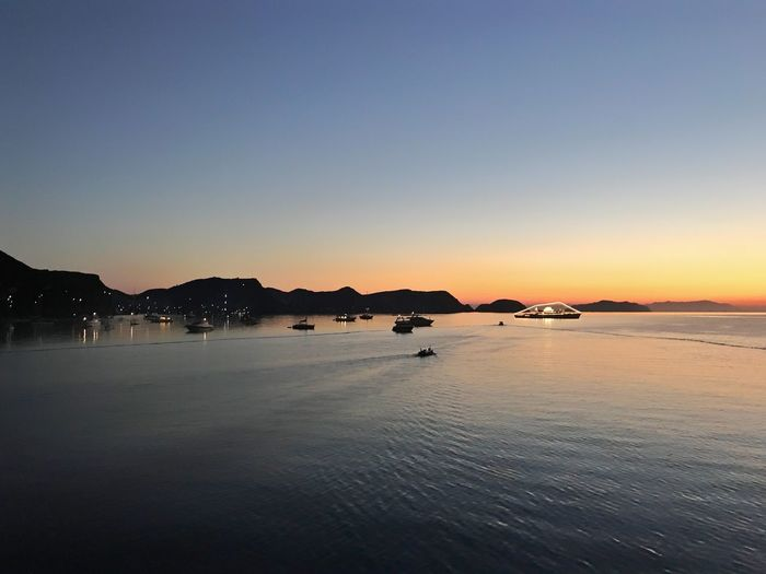 Scenics Sunset Tranquility Nature Tranquil Scene Beauty In Nature Water Outdoors Clear Sky No People Mountain Sea Waterfront Sky Blue Beach Day Sunrise