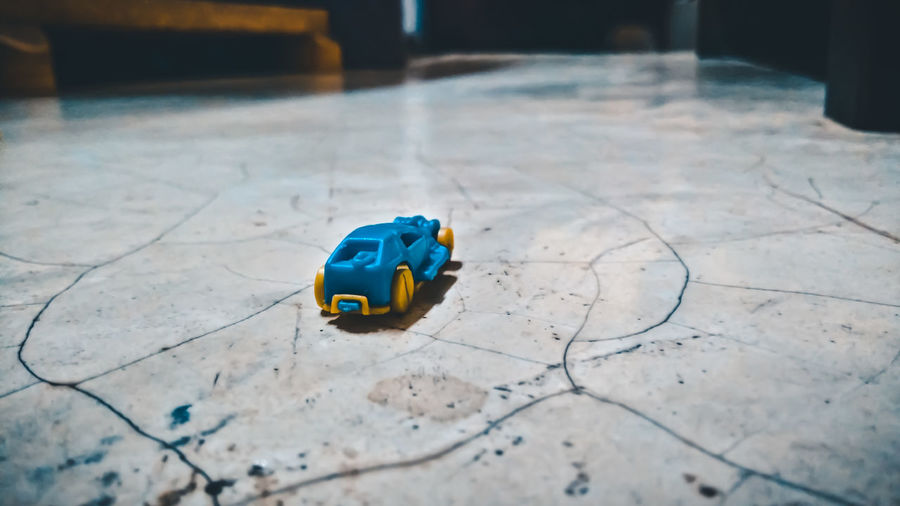 Close-up of toy car on floor