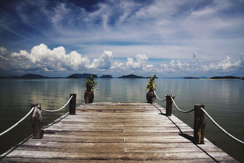 Wooden pier into paradise of andaman sea at Ko Lanta old town My Best Photo Wood Sea Water Sky Freedom Pier Thailand Tranquility Railing Direction Dramatic Sky Tropical Andaman Ko Lanta Tranquil Scene The Way Forward Horizon Over Water Cloud - Sky Wood - Material Wood Paneling Scenics - Nature Wooden Post Long No People