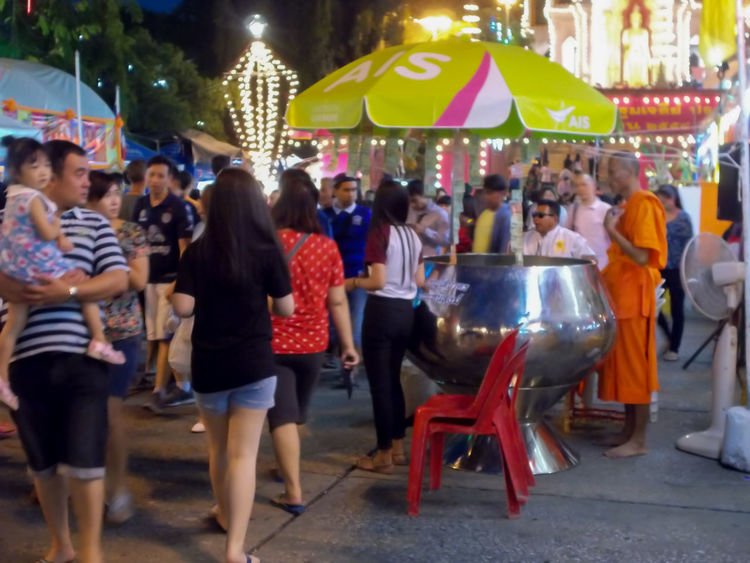 Enjoyment Large Group Of People Men Night Outdoors People Real People Women Thailand Nakhonpathom City Nightlife Standing Performance Food children Walking lightning Stage - Performance Space Togetherness Stage Light Young Adult Buddha Status Buddha status Audience Lighting Equipment Illuminated