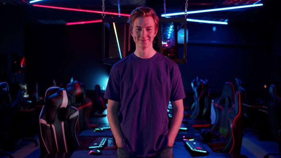 Full length of man standing at nightclub