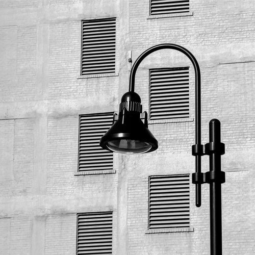 Architecture Building Building Exterior Built Structure Close-up Closed Day Electric Lamp Hanging Lighting Equipment Low Angle View Metal Minimalism No People Outdoors Protection Wall Wall - Building Feature Window