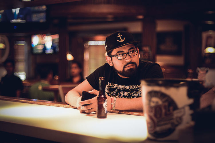 Portrait of mid adult man sitting in restaurant