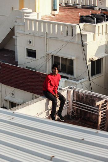 Man standing on staircase of building