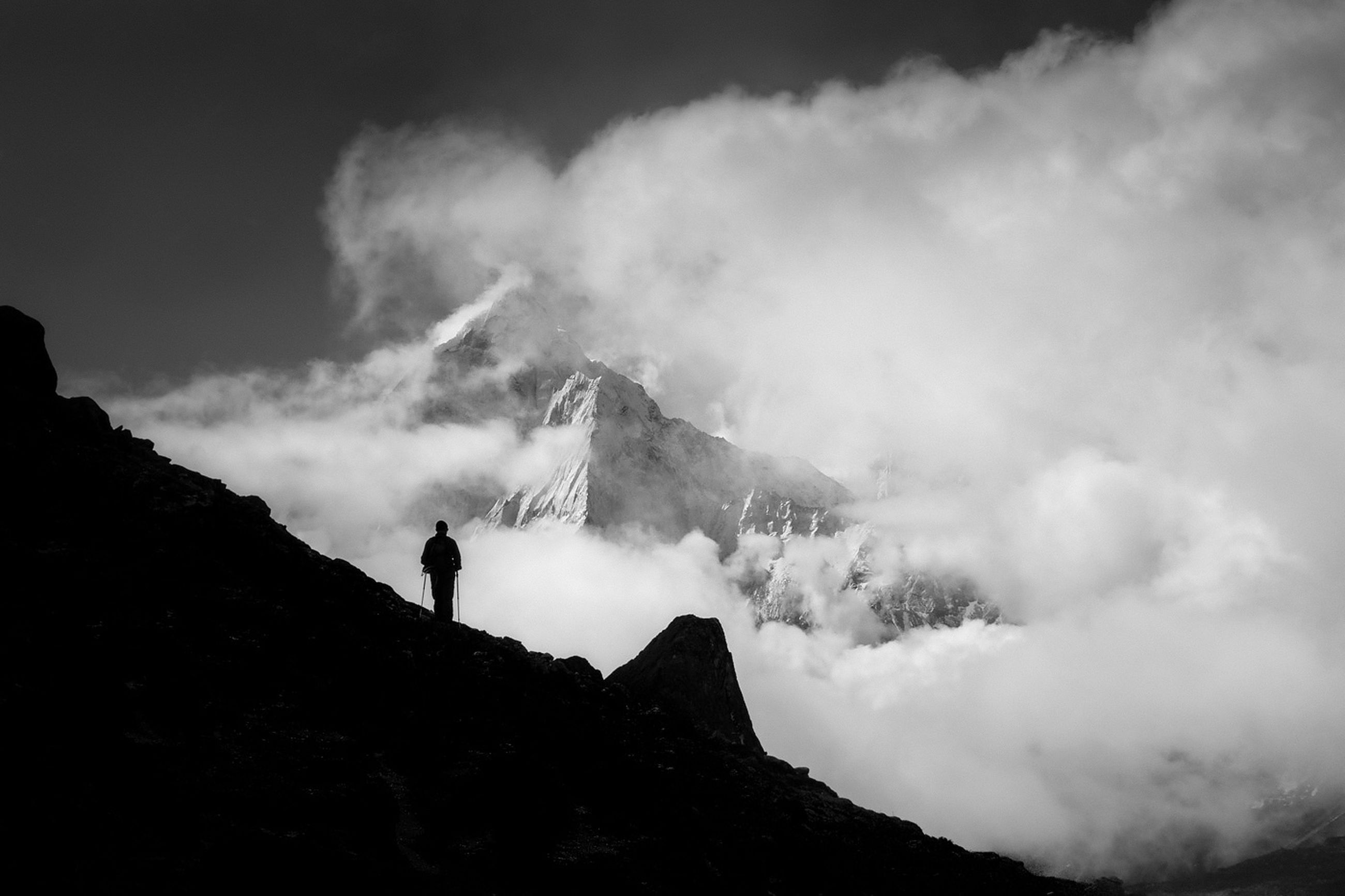 mountain, sky, weather, scenics, cloud - sky, mountain range, beauty in nature, leisure activity, lifestyles, snow, winter, men, cold temperature, tranquil scene, nature, tranquility, hiking, rock - object