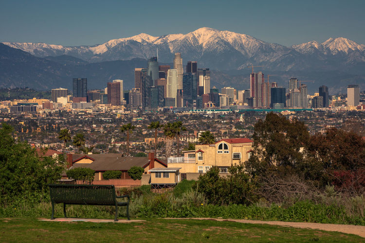 Los Angeles skyline including the snowcapped mountains, daytime Architecture Built Structure Building Exterior Building Mountain City Residential District Cityscape Tree No People Mountain Range Sky Day Landscape Skyscraper House Los Angeles, California Los Ángeles L.A. California Full Frame Snowcapped Mountain Cityscape Urban Landscape Modern