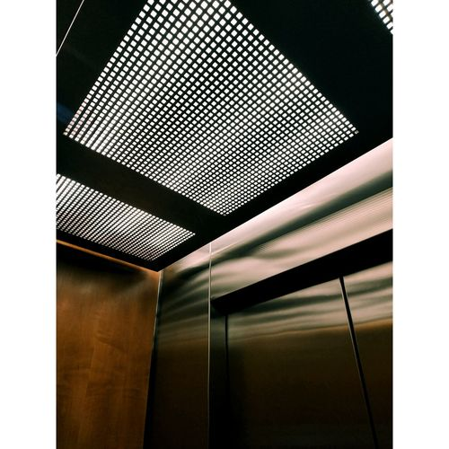 Low angle view of illuminated ceiling in building