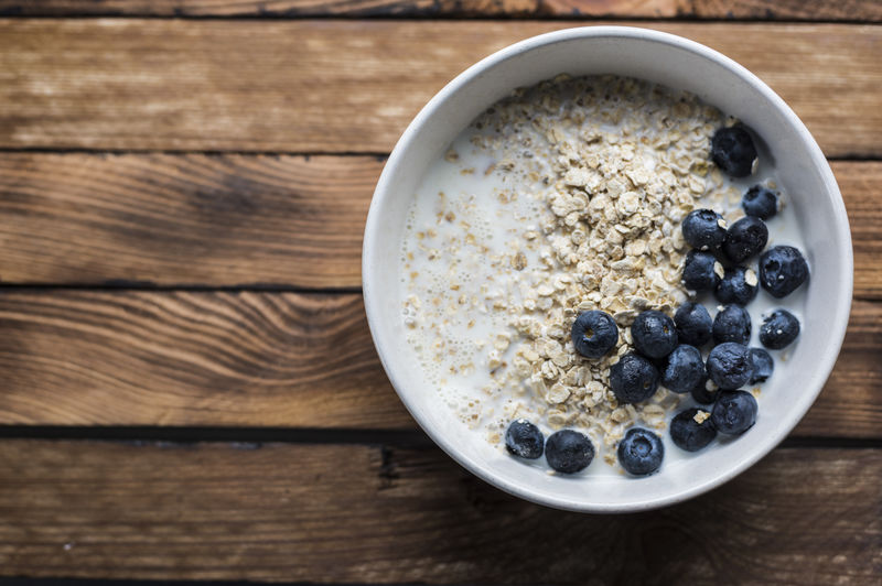 Delicious breakfast with berries and oats. Food And Drink Food Healthy Eating Wood - Material Wellbeing Fruit Blueberry Table Berry Fruit Breakfast Bowl Breakfast Cereal Freshness Meal Indoors  Oats - Food Directly Above No People High Angle View Seed Porridge Oatmeal Yogurt Antioxidant Wood Grain