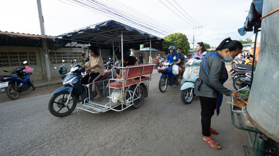 People riding bicycles on street in city