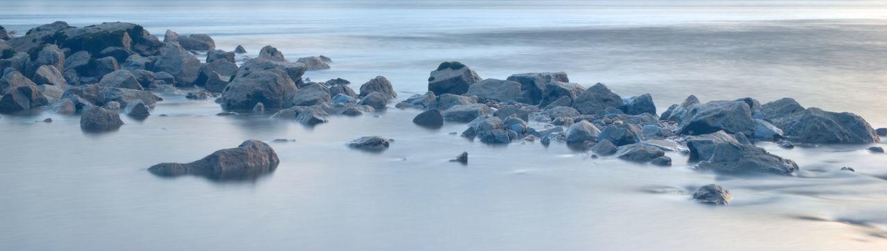 Panoramic View Of Rocks On Beach