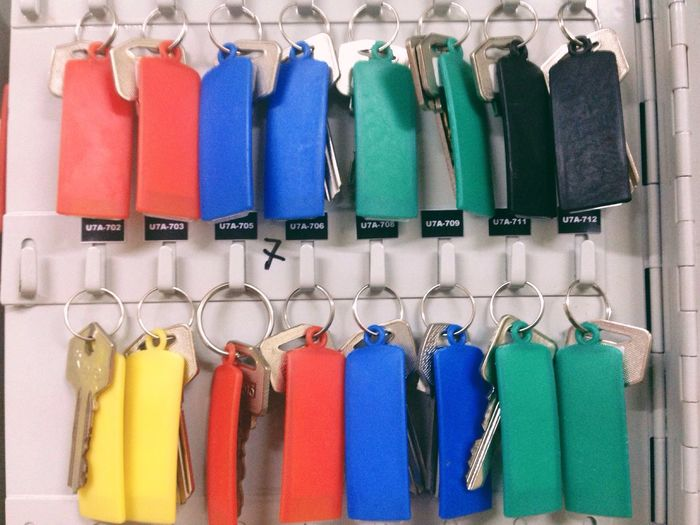 Colorful Keys Hanging On Hooks