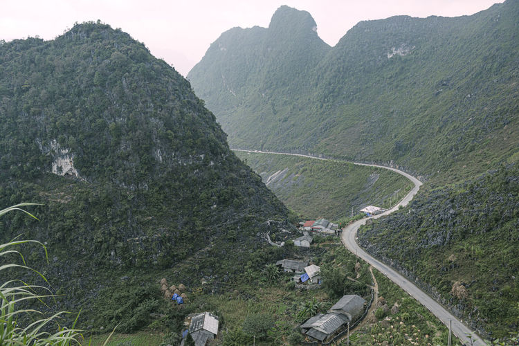 High angle view of road amidst mountains