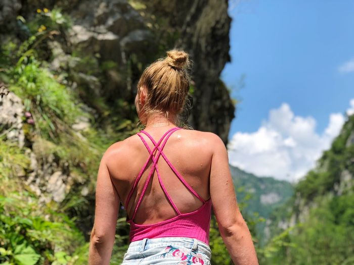 Rear view of woman against mountain